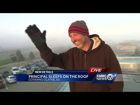 Principal at Olathe elementary school greets students from roof