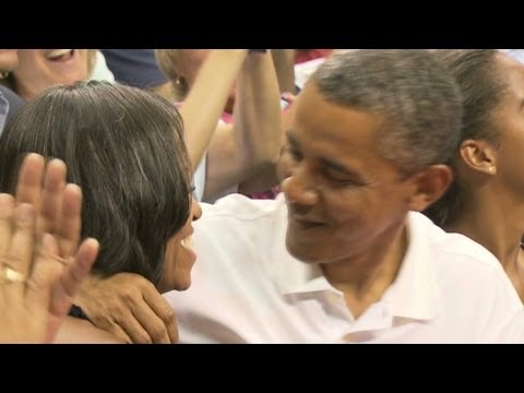 Download Obamas get do-over after 'kiss cam' fail