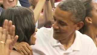 Obamas get do-over after 'kiss cam' fail