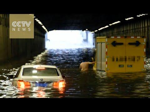 Beijing upgrades storm alert as rain batters city