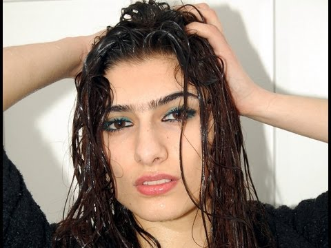 Iranian Zarina takes a shower in her clothes