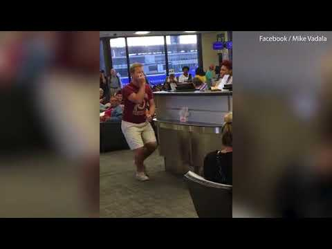Airline passenger turns flight delay into karaoke session