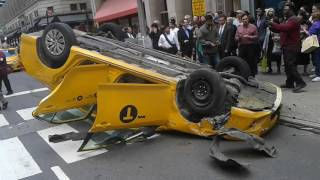 TAXI FLIPPED UPSIDE DOWN ON 5TH AVE IN NEW YORK CITY!