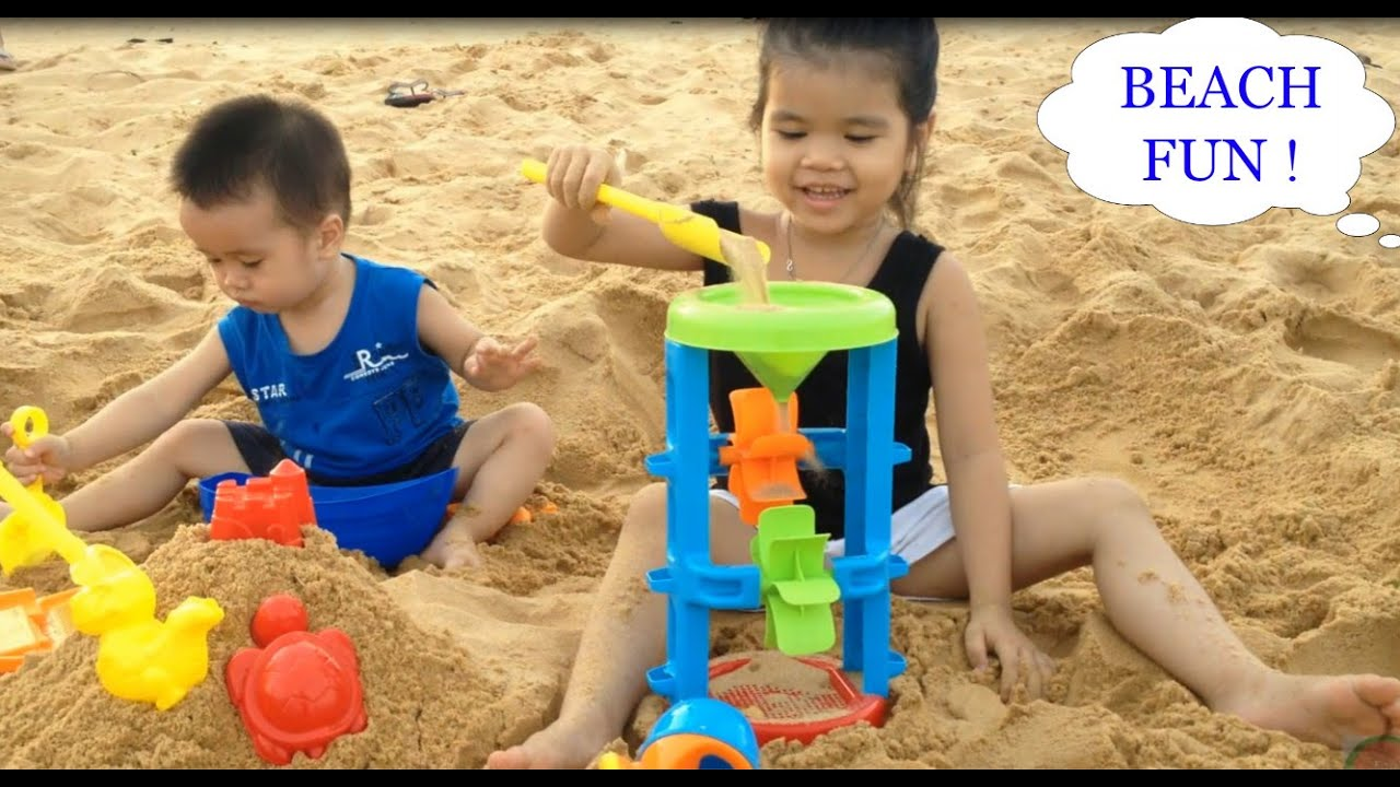 baby fun playtime on the beach children playing doll. Black Bedroom Furniture Sets. Home Design Ideas