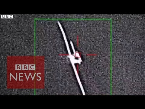 Boeing laser shoots drone from sky - BBC News