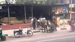 Sri Lankan Police beating a person on the road