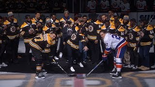 Julian Edelman spikes ceremonial puck as Bruins honor Patriots for Super Bowl title
