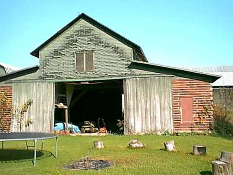 Barns of Michigan with Hugh Sintic Posing as a Farmer
