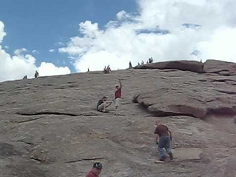Scott and Tyler climb Independence Rock, Wyoming
