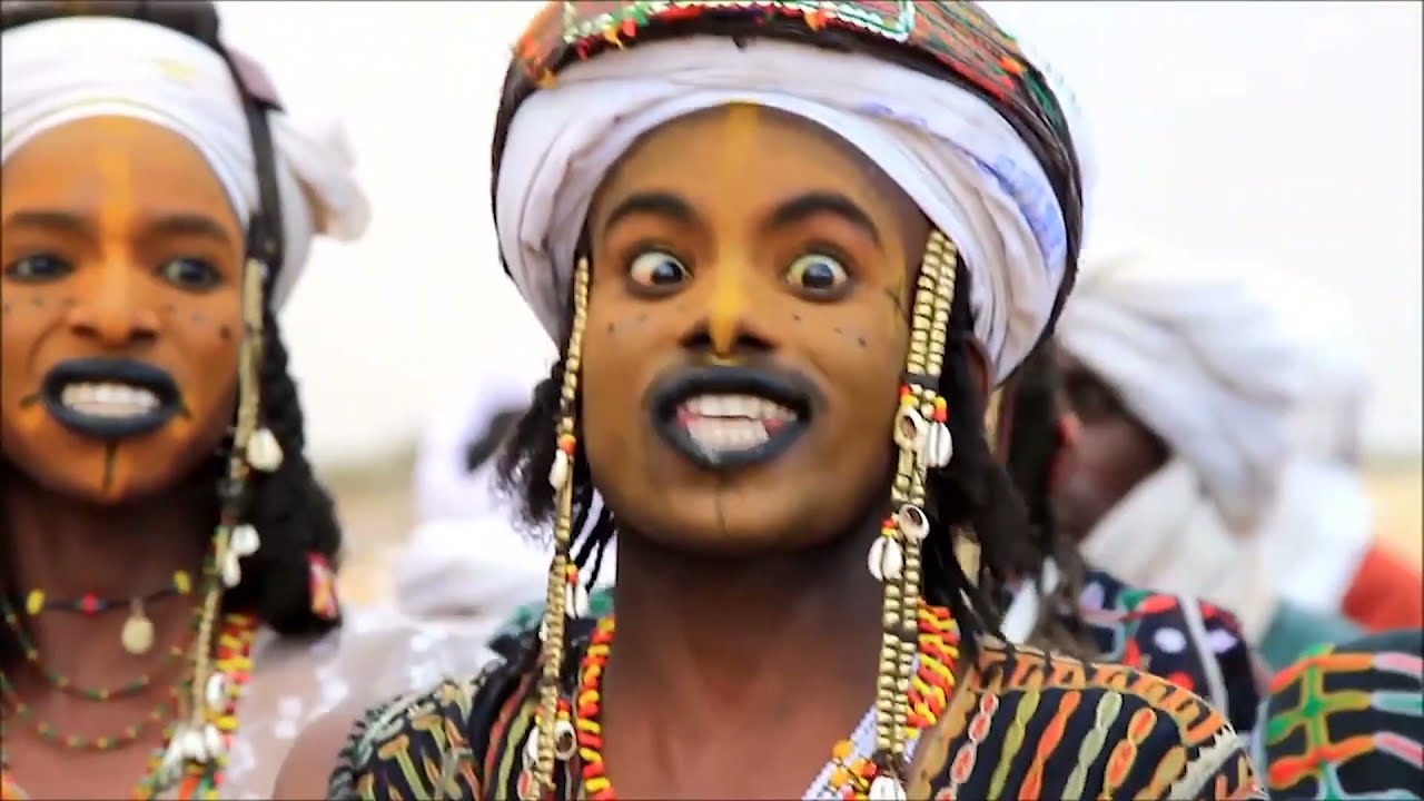 Download These African Men Wear makeup, Pop Out Their Eyeballs to Impress Women!   The Wodaabe Tribe