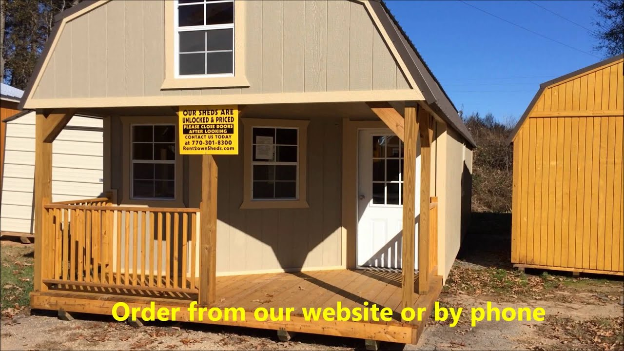 Painted storage shed cabin storage for Cabin builder texas