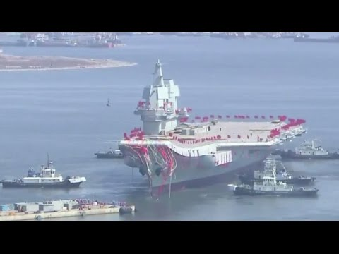 From dry dock to launch ceremony - China floats its 1st home-built aircraft carrier