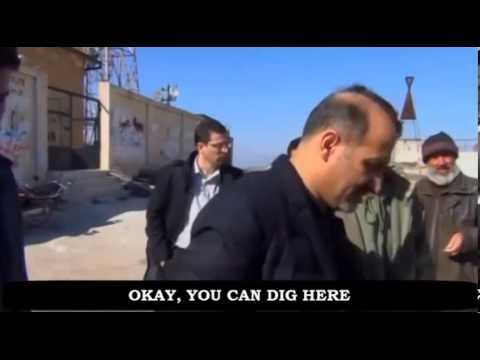 Ahmad al-Jarba visiting his burial site near the Syrian-Turkish border