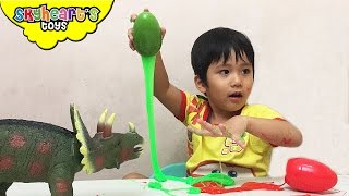 Dinosaurs in SLIME (Yuck!) - Playtime with triceratops dinosaur surprise eggs toys for kids