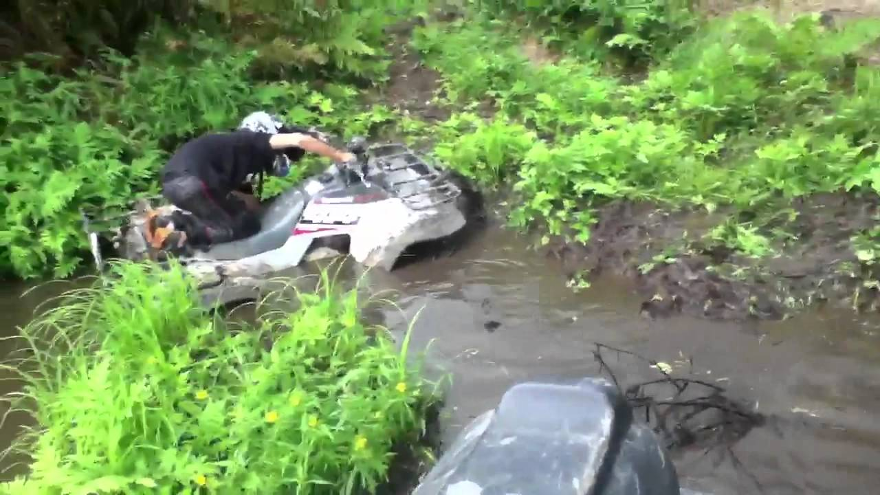 kawasaki bayou 400 in the mud - youtube