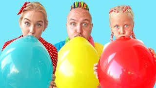 Alisa plays outdoor games with Balloons and have fun with dad and mum