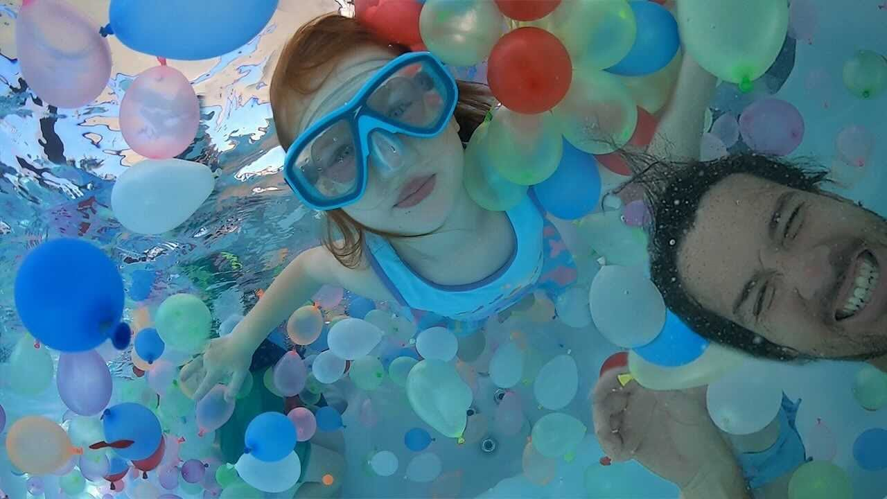 Download Swimming in 1,000 WATER BALLOONS!!  Playing in the Pool and family Helicopter Ride at pirate island!