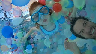Swimming in 1,000 WAṪER BALLOONS!! Playing in the Pool and family Helicopter Ride at pirate island!