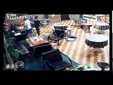LiveLeak.com - Thugs with sugarcane machetes hack people and property in restaurant