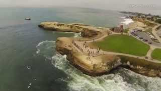 Aerial footage of surfers at Steamer Lane Santa Cruz, CA