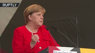 'Merkel must leave': German chancellor booed & heckled at campaign rally in Brandenburg