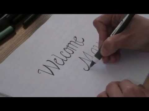 cursive fancy letters - how to write Welcome May