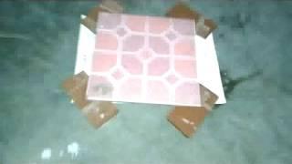trik memecahkan keramik dengan menggunakan bohlam lampu