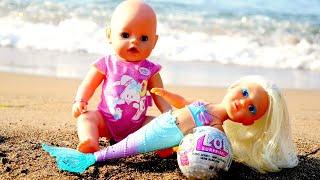 Фото Vidéo Intéressante Pour Enfants. Cadeau De Sirène. Baby Born Joue Avec L.O.L. Surprise à La Plage.