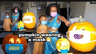 HOW TO CARVE A HALLOWEEN PUMPKIN WEARING A FACE MASK