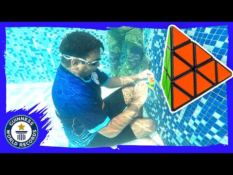 Most Pyraminx (Rubik's Cubes) solved underwater - Guinness World Records