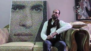 بالفيديو والصور  بـ8 آلالاف مسمار.. فنان يحول أبو تريكة للوحة فنية