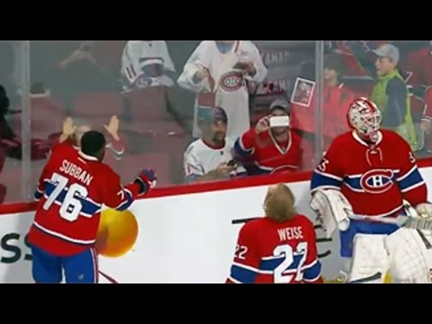 Subban tosses puck to young fan in the stands