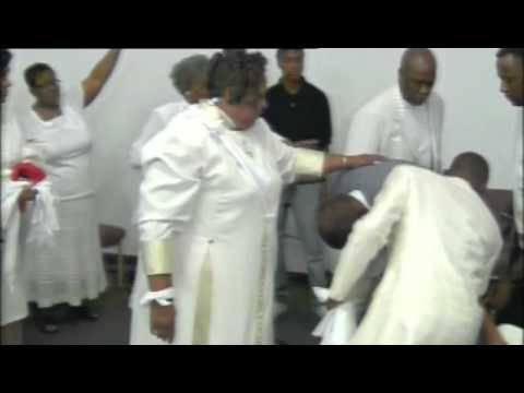 Laying Hands...Pastor Cynthia Moore & Apostle Leviticus Moore