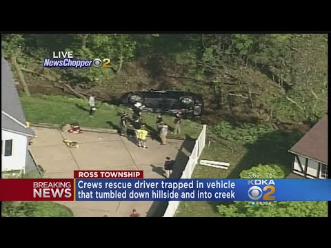 Driver Pulled Out Of Vehicle After Rolling Over Hillside Into Creek
