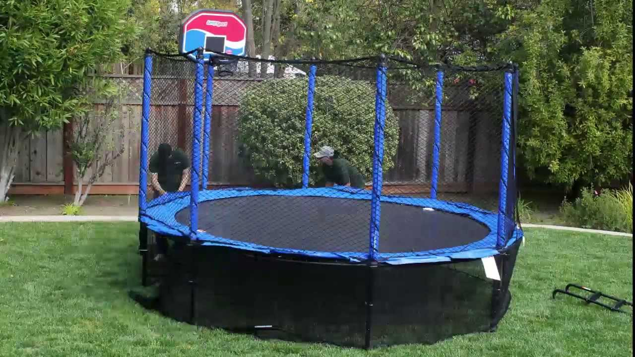 Jumpsport trampoline install in 45 seconds youtube for How to put a trampoline in the ground