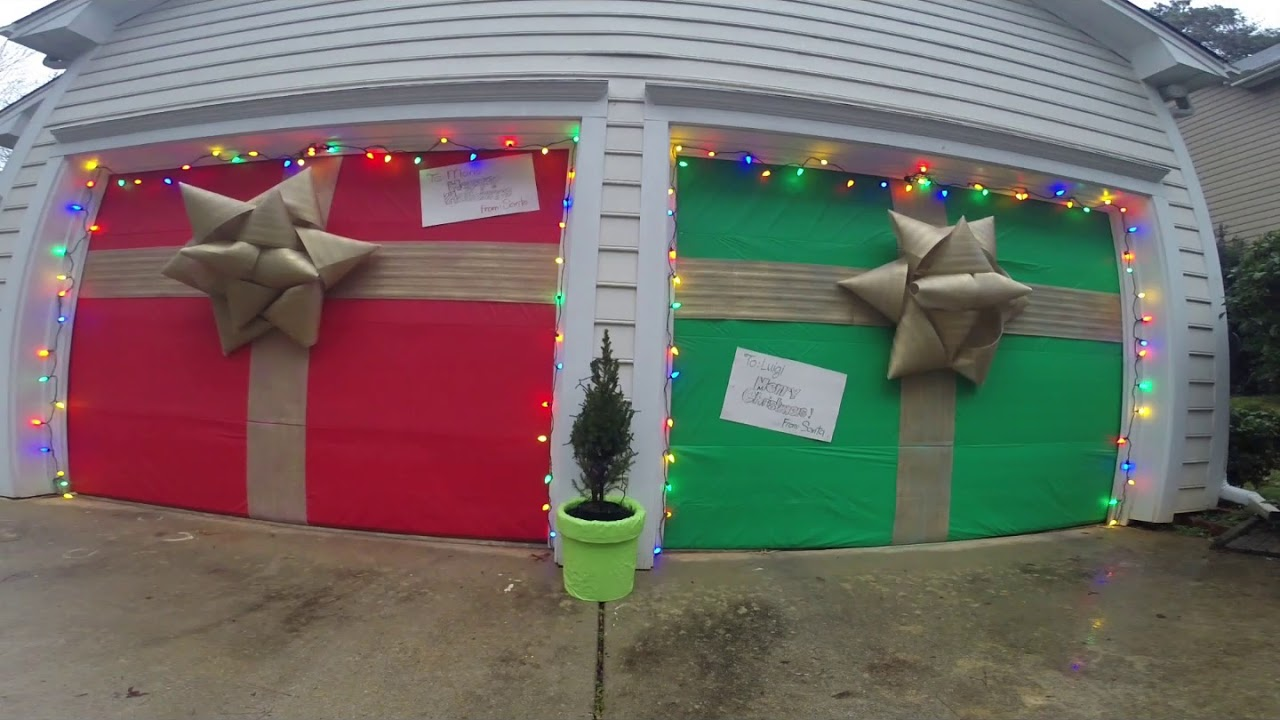 Decorate your garage doors as CHRISTMAS PRESENTS!!!