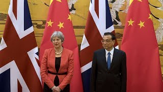May talks about Brexit impact on UK, the rest of the world