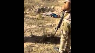 Graphic images- Iraqi army executed a claimed Tunisian member of ISIS