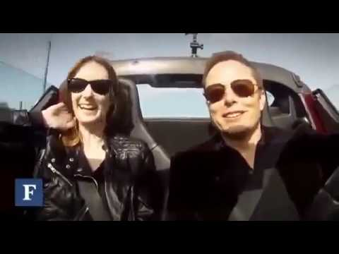Elon Musk takes a reporter for a spin in the Tesla Roadster