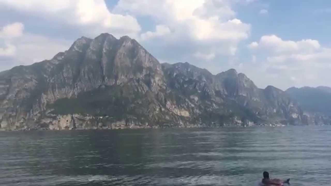 Riva di Solto Spiaggia Lago Iseo e Monte Isola  YouTube