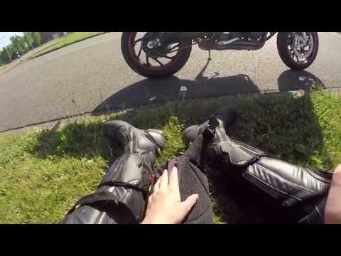Girl makes wheelie on a Husqvarna nuda 900