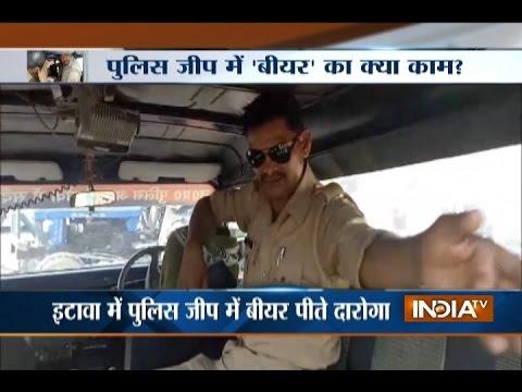 UP: Cops caught drinking beer inside police jeep in Etawah