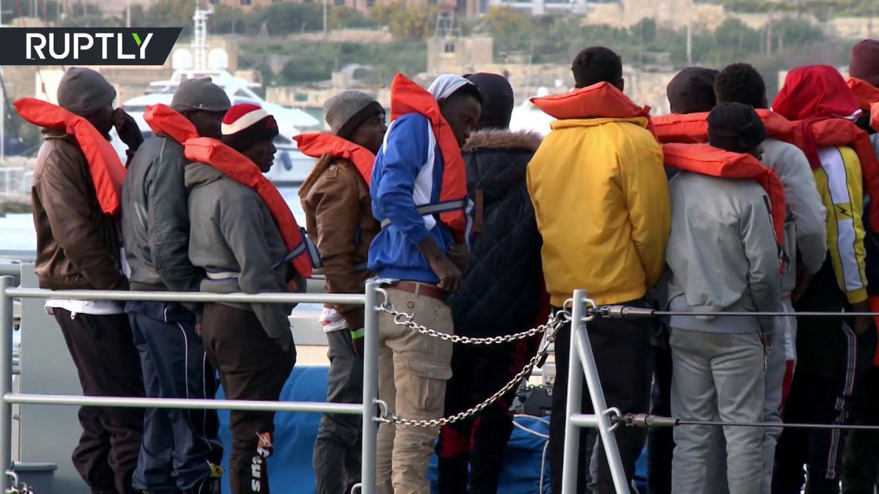 Watch: Asylum seekers disembark in Malta