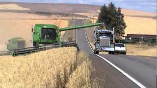 john deere combine unloading on go highway
