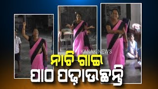 School Teacher Teaching in Dance Style At Odisha