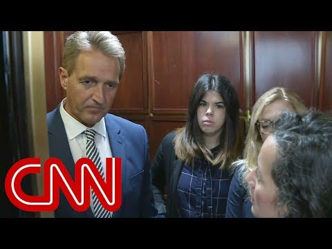 Tearful woman confronts Senator Flake on elevator