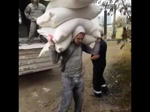 Just Russian loader carries 250 kg of cement