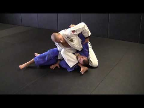Rafael Lovato Jr. shows a triangle from side control