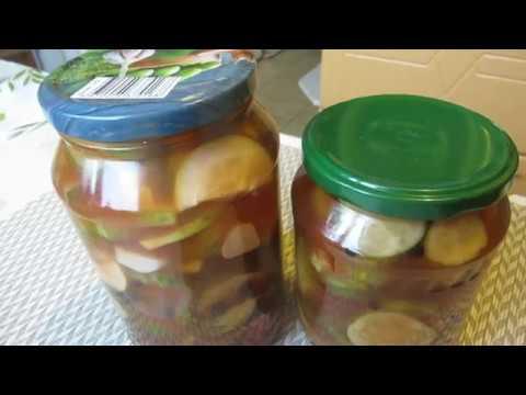 Огурцы на зиму резаные с чесноком в томатной заливке.