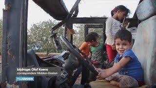 Syrische familie woont in uitgebrande bus